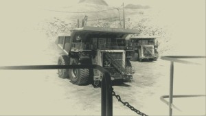 Black and white picture of two 400 ton mine haulage trucks taken from deck of a mine haulage truck