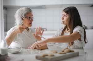 Elderly lady gives a middle age woman advice