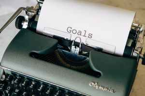 Typewriter with Goals typed on paper