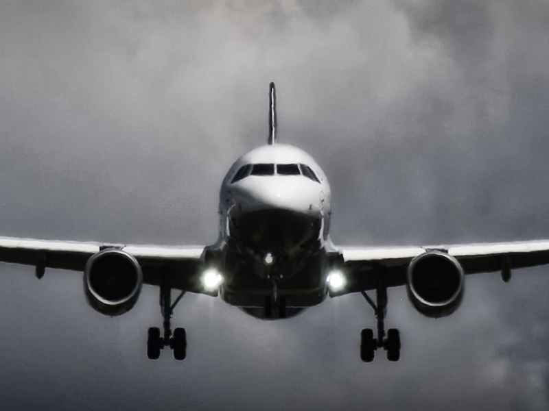 flight airliner in grayscale photo