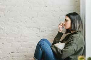 Teenage girl sitting in corner
