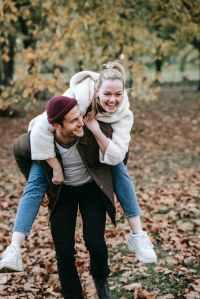 Man carrying a woman piggyback
