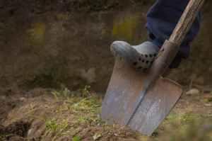 Man stepping on shovel