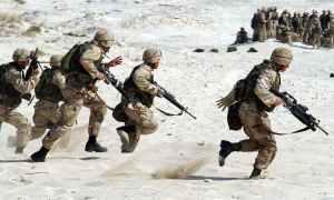Soldiers running across the desert